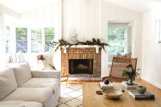 fall-inspired mantel decor above brick fireplace surround