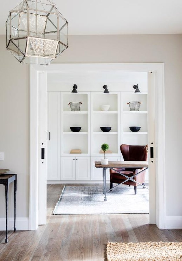 Home Office Doors with Pocket doors in a home office by Amber Interiors