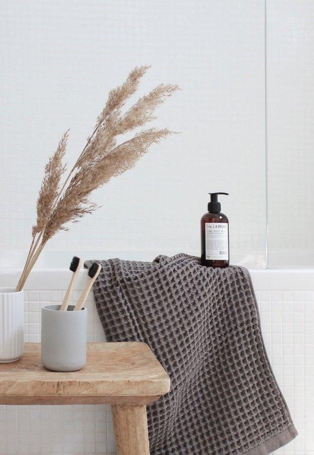 bathroom with gray waffle weave bath towel