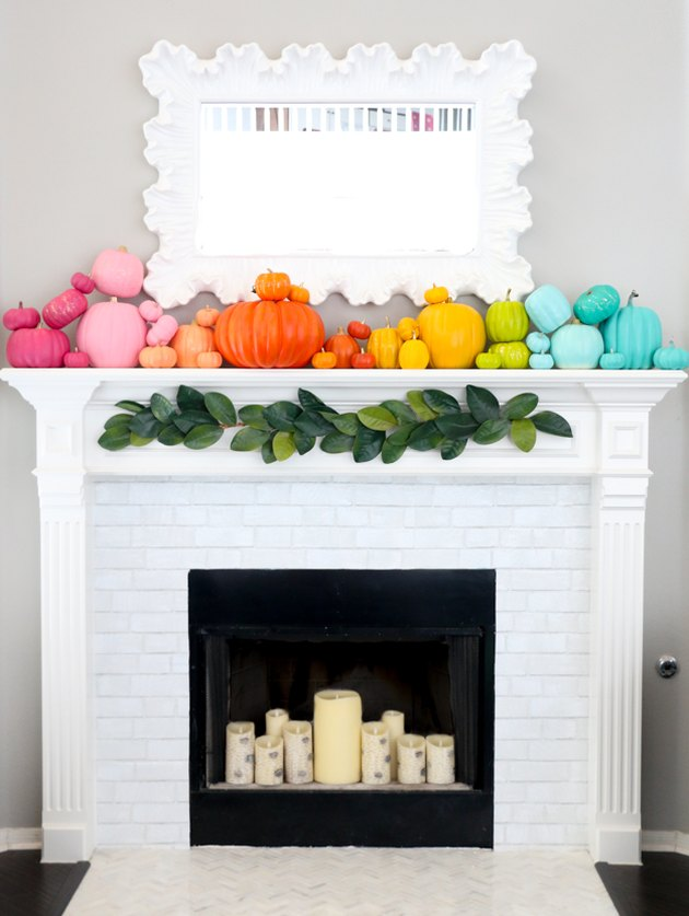 fall-inspired mantel decor with rainbow colored pumpkins