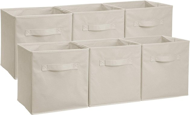 Cream fabric storage containers with handles on white background