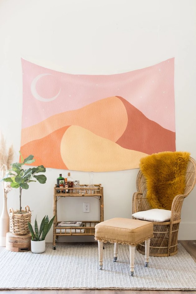 warm colors in room with wall tapestry with boho decor