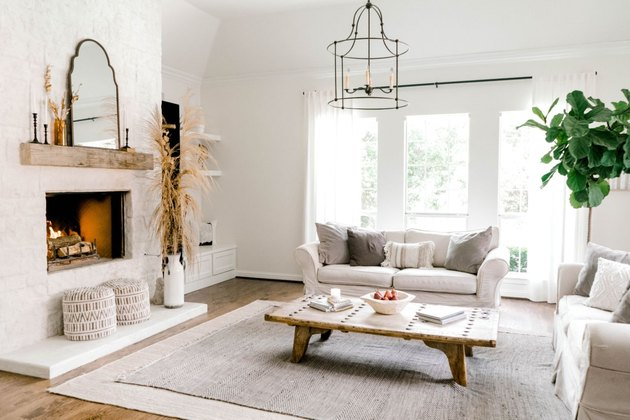 white farmhouse family room idea with fireplace and white furniture