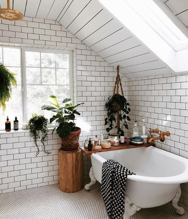 bathroom idea with white subway tile on the walls and mosaic penny tile on the floor with clawfoot tub