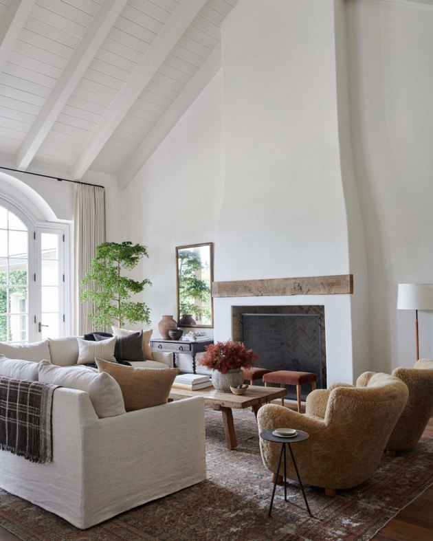 white farmhouse family room idea with colorful chairs and white sofa