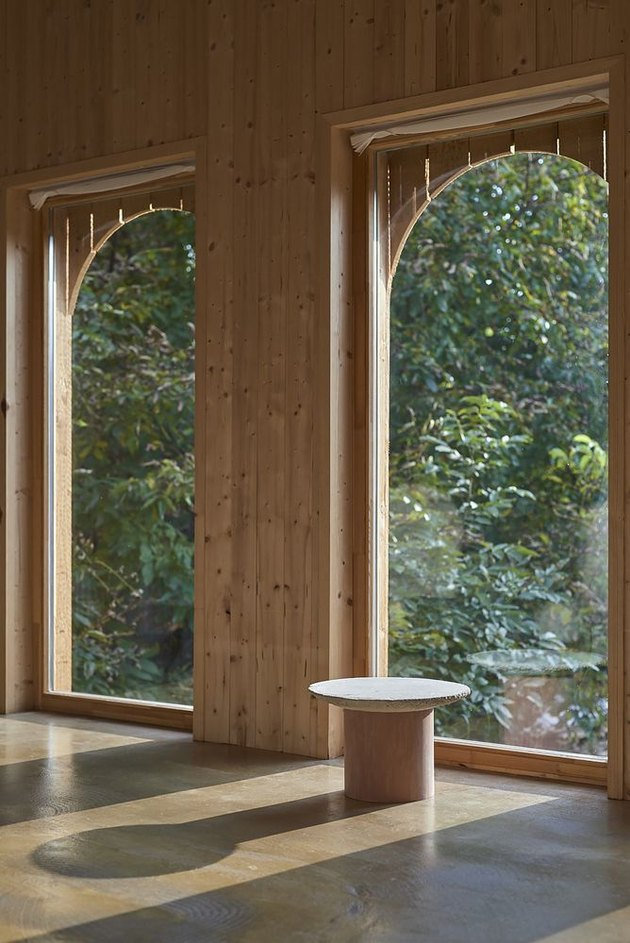 interior arched windows overlooking lush landscape