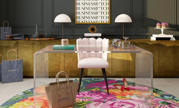 Home Office Paint Colors with Clear plexi desk, pink desk chair, gold credenza, white lamps, pink round area rug.