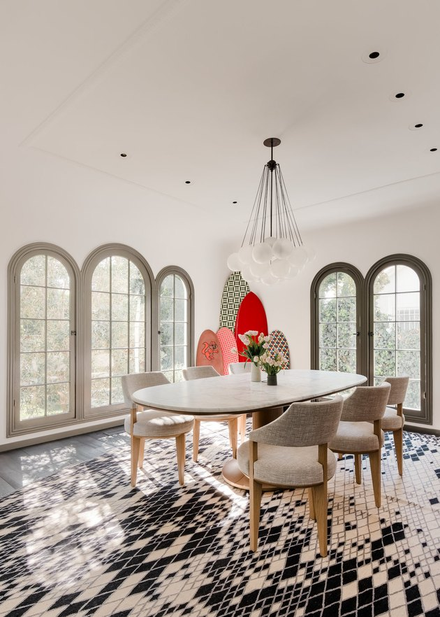 white dining room with arched windows