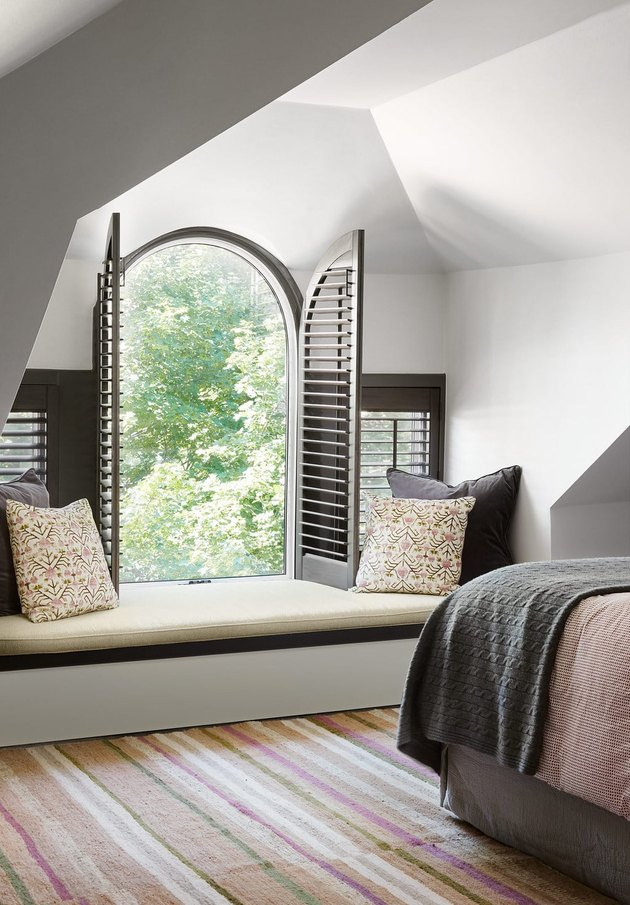 arched window in attic with bench