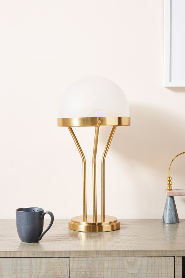 brass and white lamp
