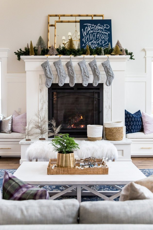 white Christmas mantle with Christmas Stocking Holder and gray stockings by Studio McGee