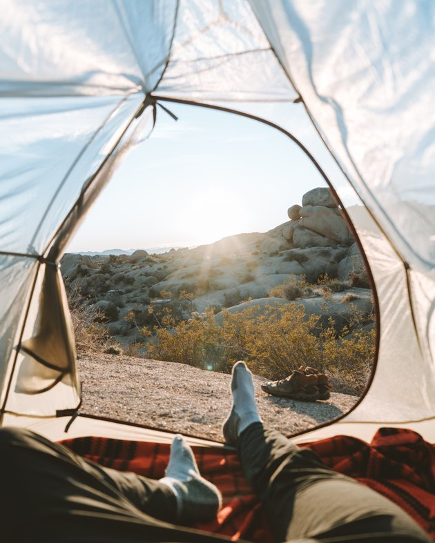 person in tent with view of nature