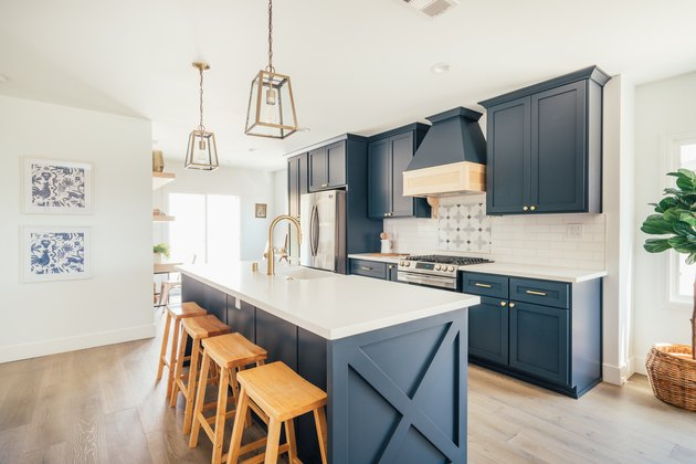 Blue and white modern farmhouse kitchen with brass and glass pendant lights