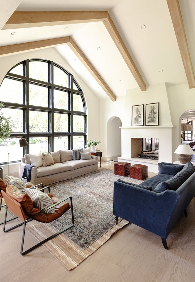 a-frame living room with arched window