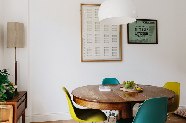 Small dining room with wood table and colorful chairs