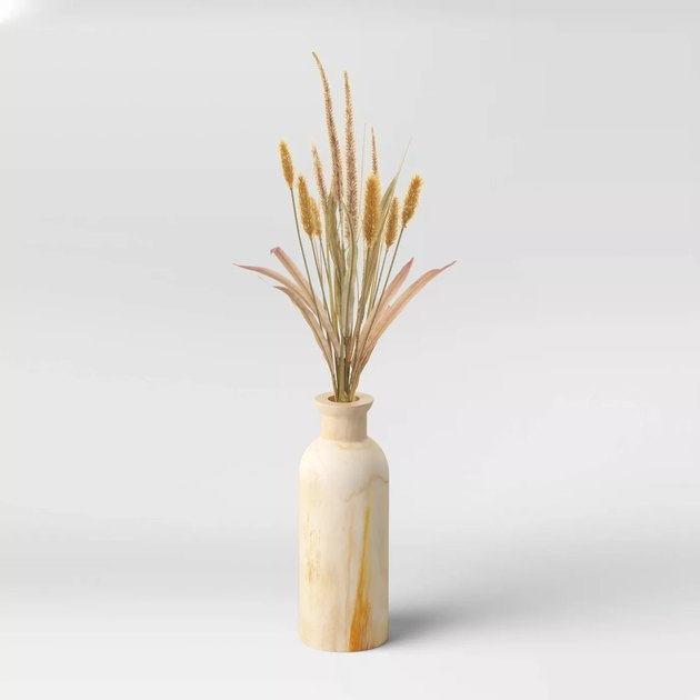artificial foxtail arrangement in wood vase