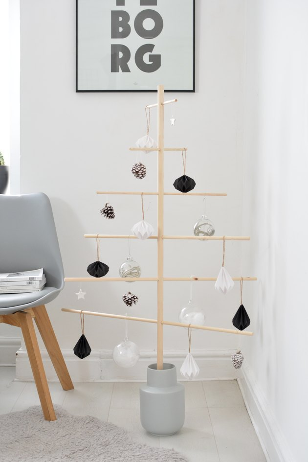 minimal wooden Christmas tree with black-and-white ornaments