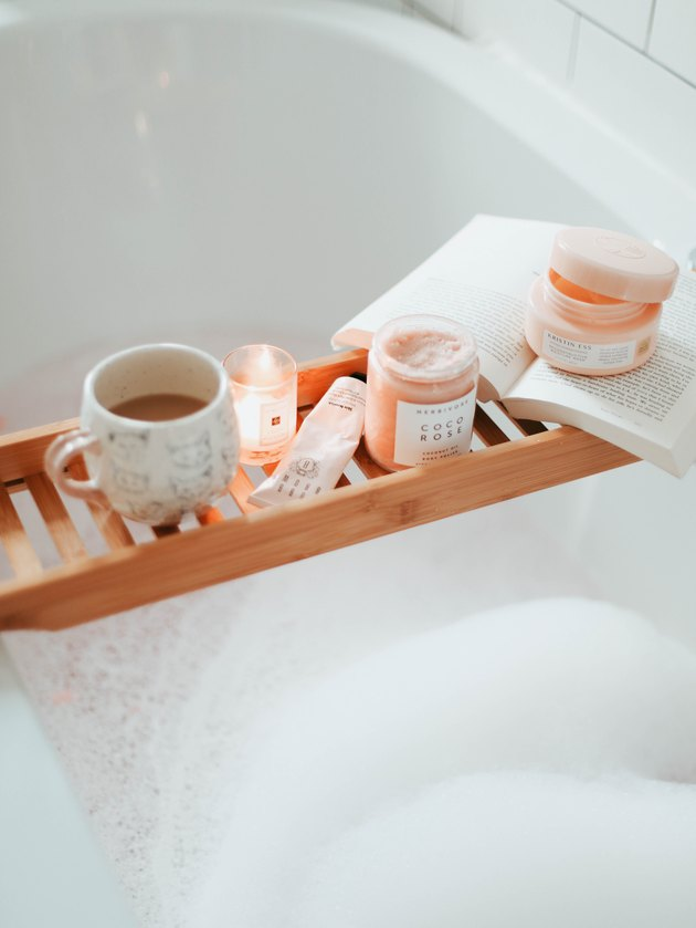 bubble bath with bathtub tray and mini candle