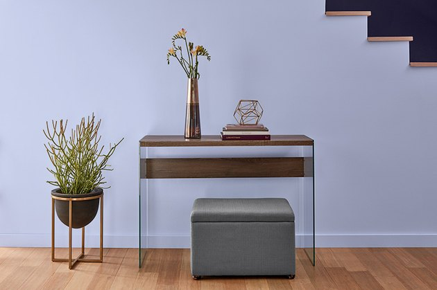lavender wall with entryway furniture and plant