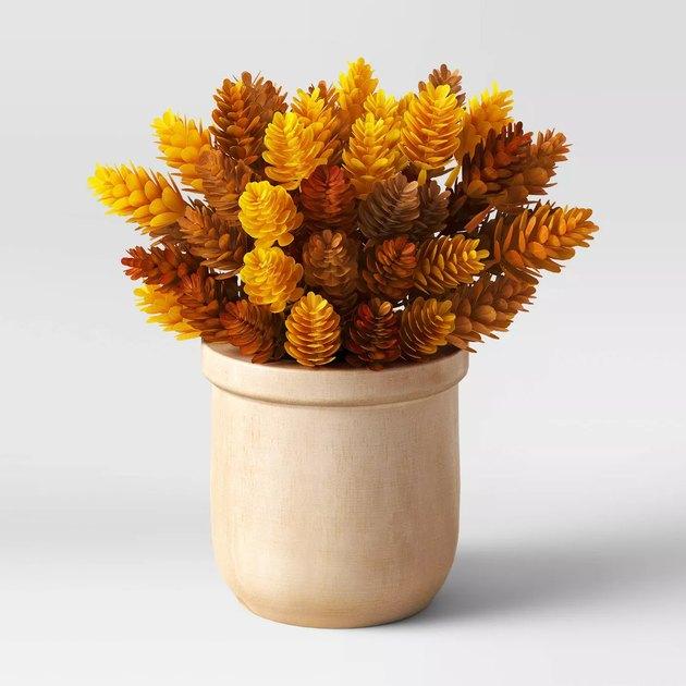 artificial hopps arrangement in wood pot
