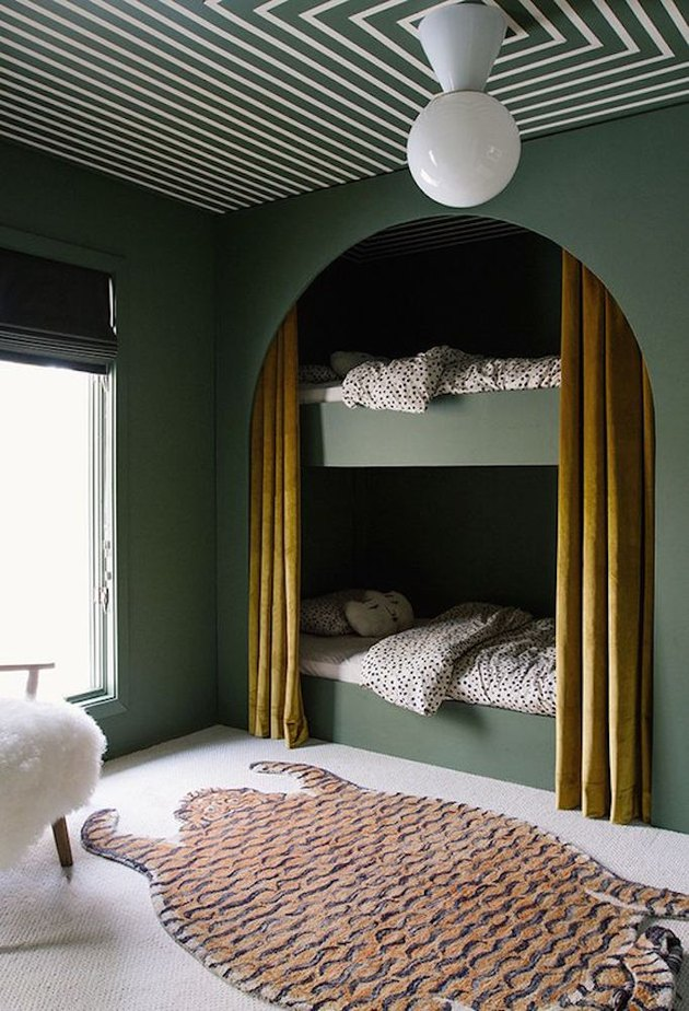 forest green bedroom color idea with bunk beds and patterned ceiling