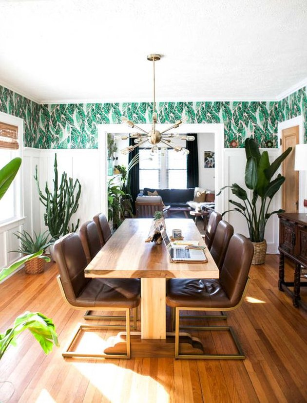 tropical dining room wall idea with patterned wallpaper in bohemian space with wood table