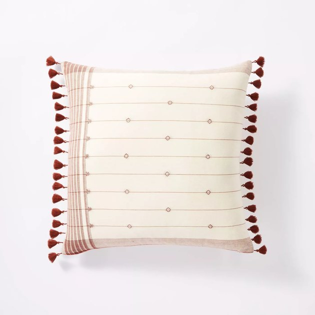 throw pillow with striped pattern and small tassels