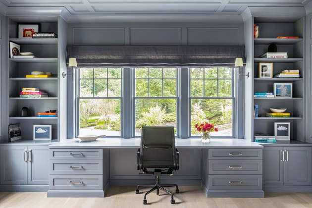 Home Office Paint Colors with Gray built in shelves and desk, black desk chair.
