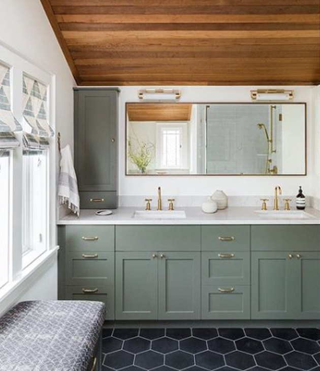bathroom idea with vanity light bars above mirror and green cabinets