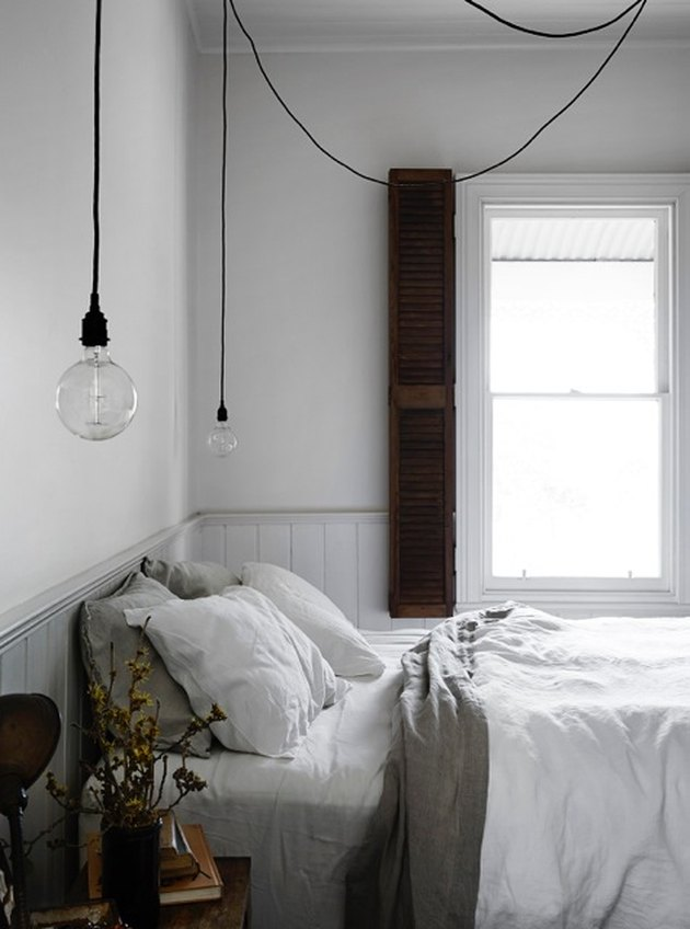 farmhouse bedroom with suspended pendant lighting