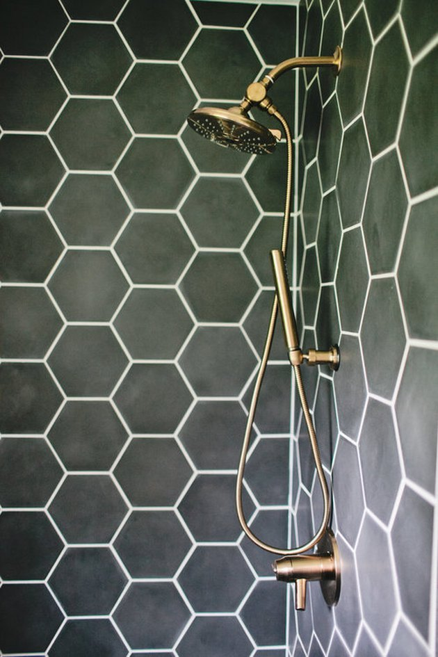 hexagonal green bathroom tile idea in the shower with brass fittings