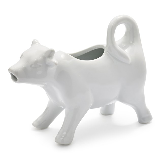 white porcelain cow dispenser