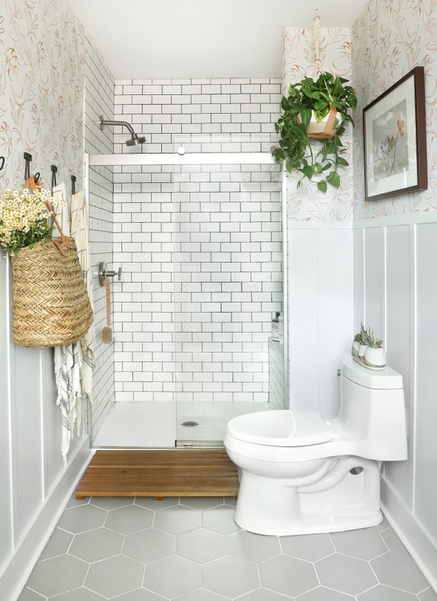 bathroom idea with white subway tile in shower and hexagonal floor tile