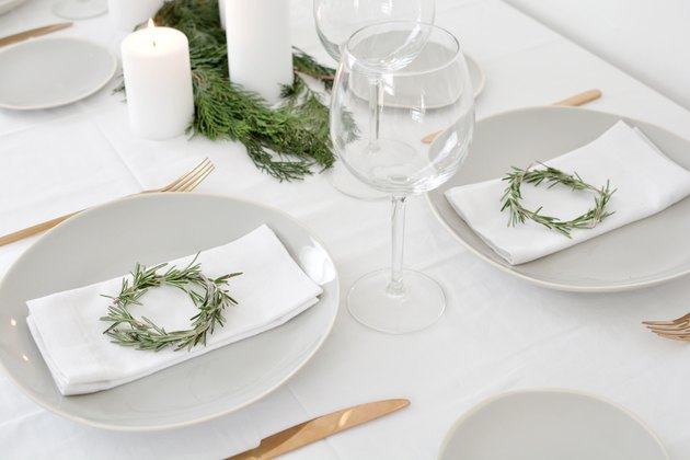 DIY rosemary wreaths for a holiday table setting.
