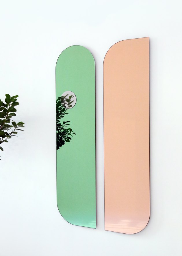 two mirrors in green and peach colors