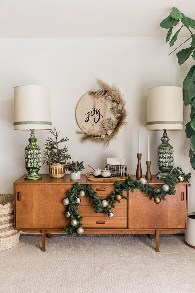 This minimalist Christmas craft is made from an an off-the-shelf wooden tabletop and luxe dried flowers.