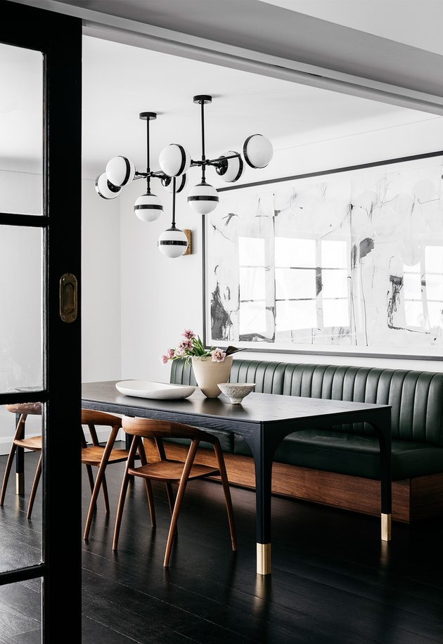 contemporary dining room idea with monochrome statement light