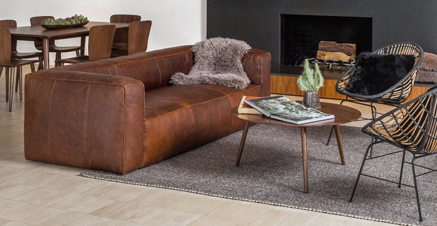 article amoeba coffee table with couch and chairs nearby