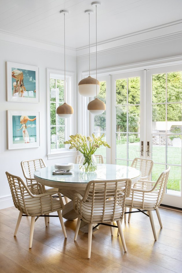 round dining room table idea with hanging pendants above next to French doors