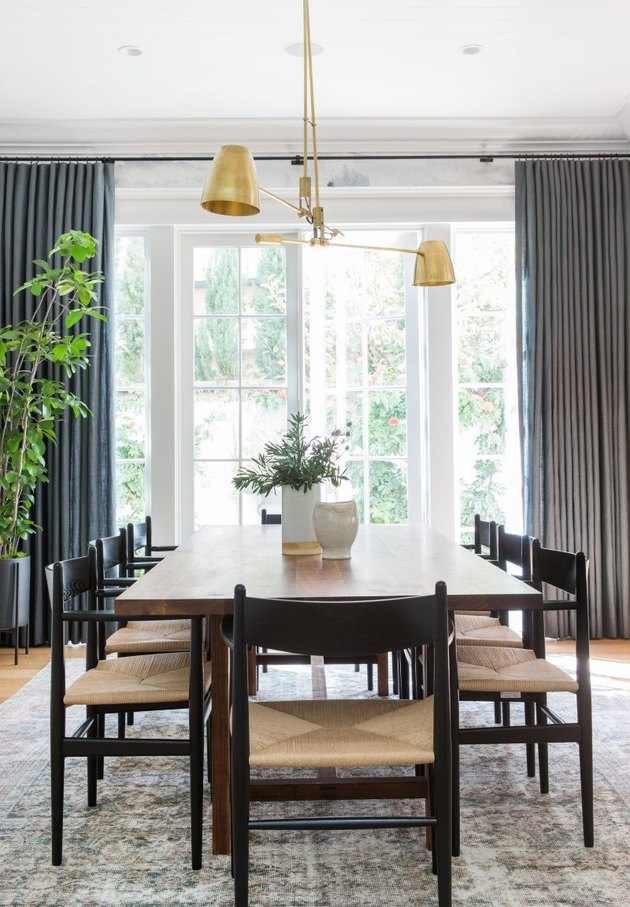 dining room table idea in front of French doors and floor-to-ceiling drapery