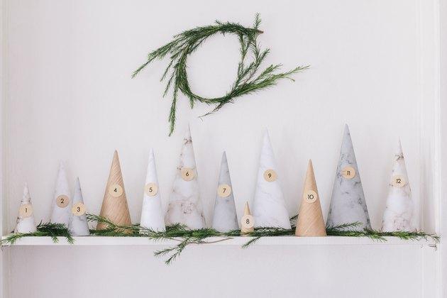 paper tree advent calendar on shelf