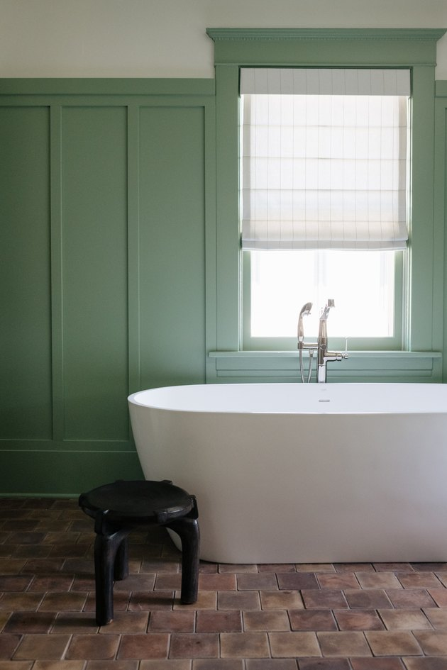 mint green bathroom color and brown floor tiles and freestanding tub