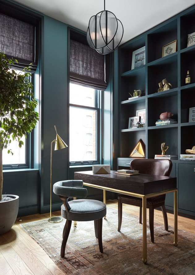 bauhaus colors in living room with teal walls