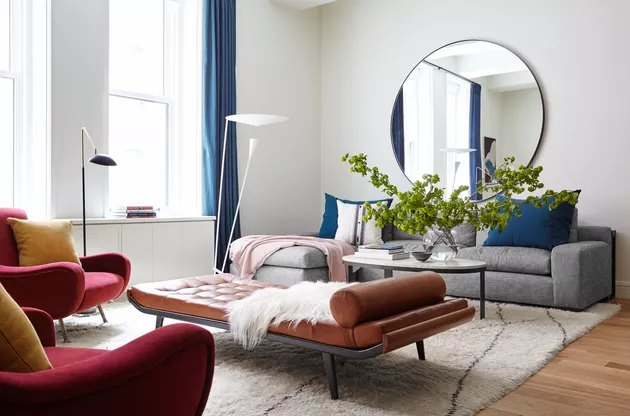 bauhaus colors in living room with leather chaise and grey sofa