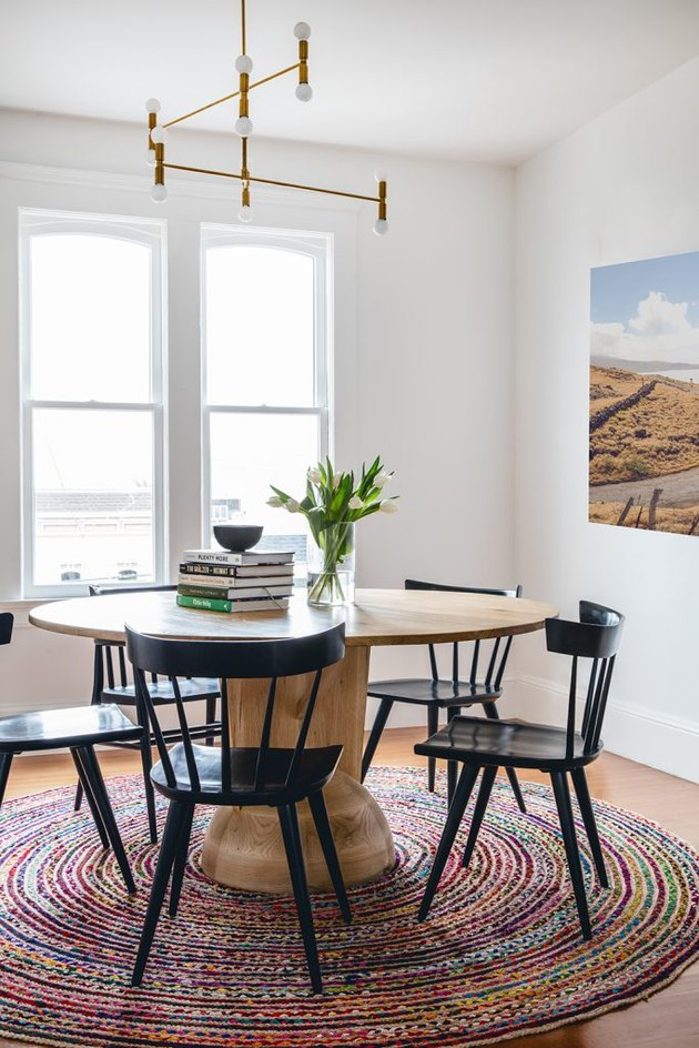 dining room design idea with round table and rug is used to define space