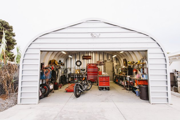 Garage Organization Tips and Tricks with motorcycle and red storage