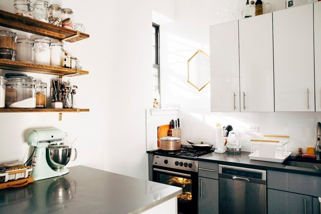 small kitchen with stainless steel countertops and open shelving