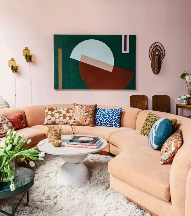 bauhaus colors in living room with pink walls and abstract art