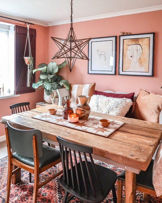 dining room lighting idea with star-shaped pendant in bohemian space with pink walls