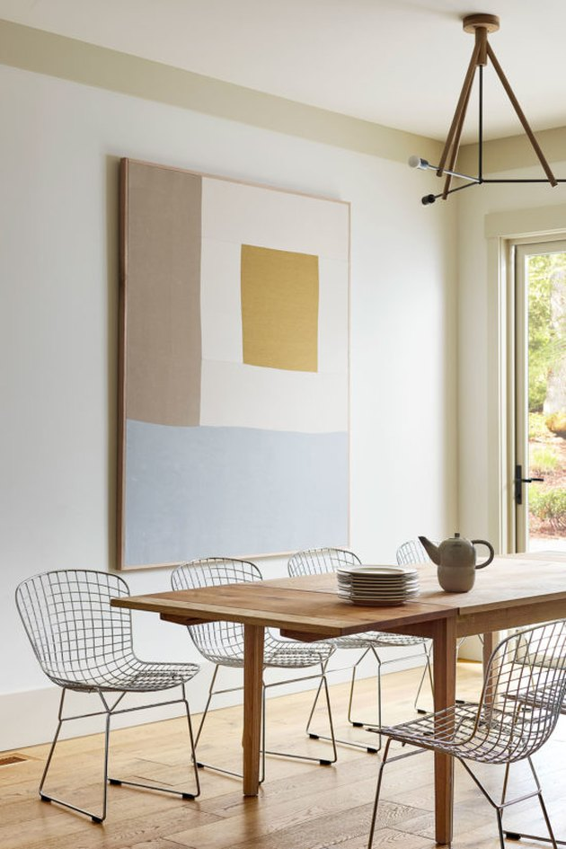 dining room design idea with artwork used to define space